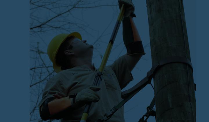 Lineman on a power pole